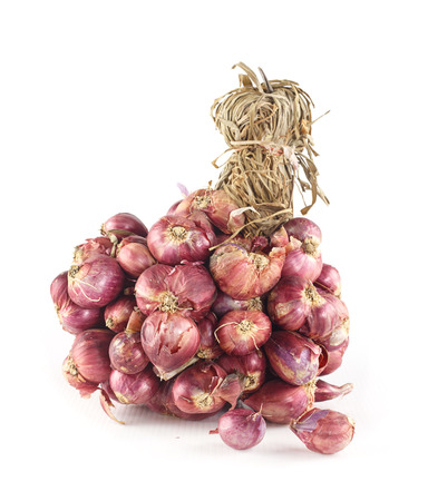 Bunch of fresh shallots on white background
