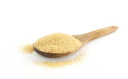 Heap of  brown sugar on wooden against white background Stock Photo