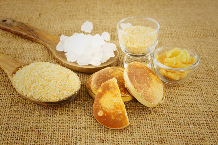 Many sugar - crystaline,coconut,palm sugar on brown background Stock Photo