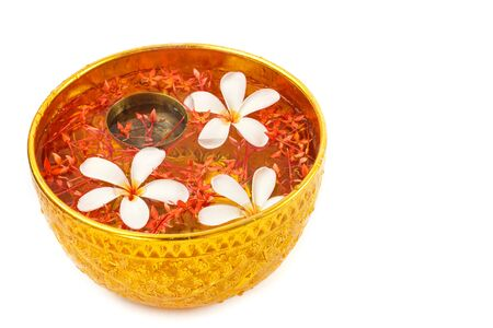 songkran: Songkran festival - Bowl of water with flowers on white background
