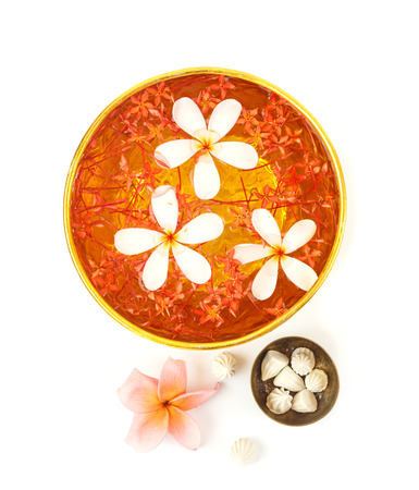 Songkran festival - Bowl of water with flowers on white background