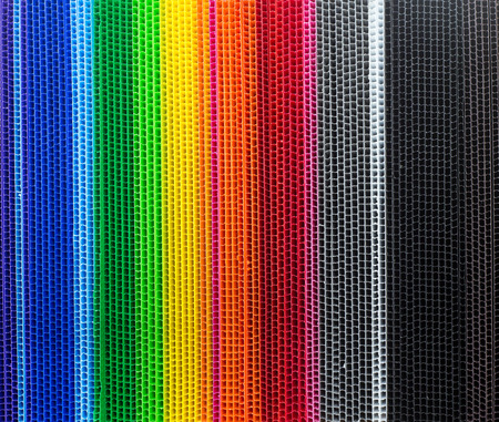 Colorful corrugated plastic arrange in row as background Banque d'images