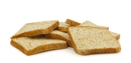 Group of sliced whole wheat breads on white background