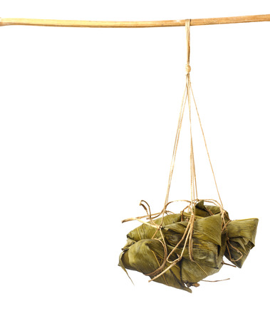 Zongzi - chinese sticky rice dumpling hang on wood against  white background