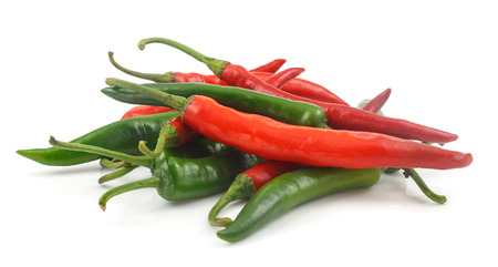 white pepper: Fresh red and green cayenne pepper on white background