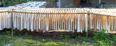 rubber sheet: Natural rubber sheets hang on bamboo hanger