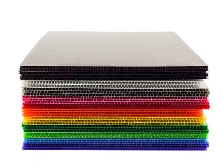panel: Stack of colorful  corrugated plastic sheets isolated on white