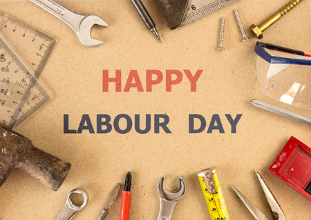 Labour day background - tools on brown background