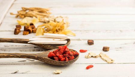 Goji berry and chinese medicine on white background