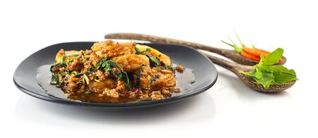 Dish of stir fried eggs tofu with pork  and holy basil on white Stock Photo