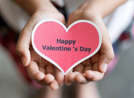 Happy valentine day card - red  heart shape on hands
