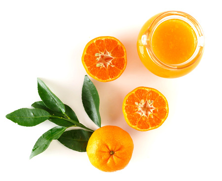 Top view of orange fruit and juice on white background