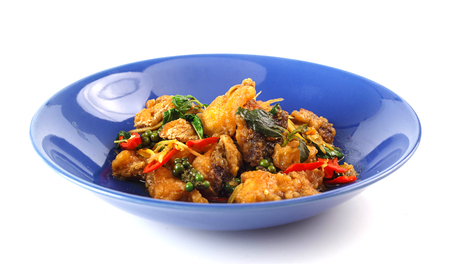 Thai spicy food - stir fried snapper with pepper and chilli on white Stock Photo