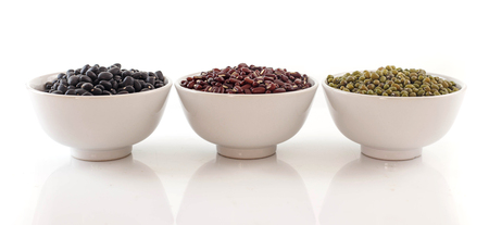 Bowl of red, black and mung bean arrange on white background