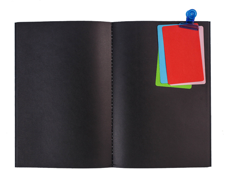 Blank black notebook and colorful notepaper  isolated on white
