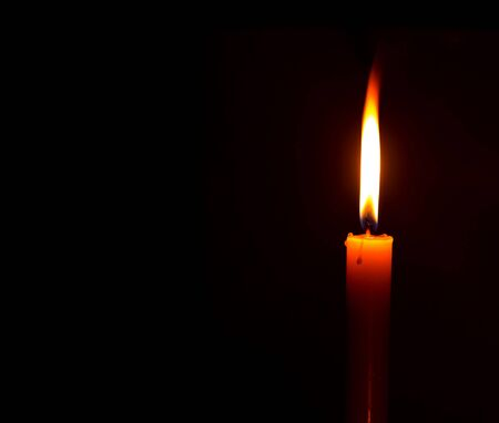 Candle light for spirituality ceremony against black background