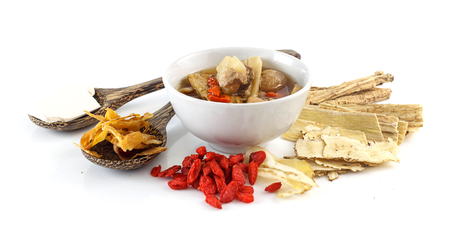 Pork rips clear soup with chinese herbs on white background
