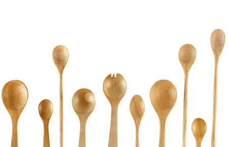 Top view of wooden spoons and fork on white background