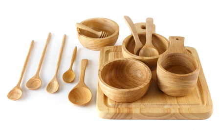 Group of wooden utensils on white background