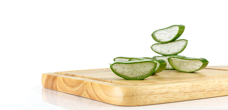 Slice aloe vera on wood against white background Banque d'images