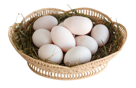 Fresh duck eggs in the basket isolated on white