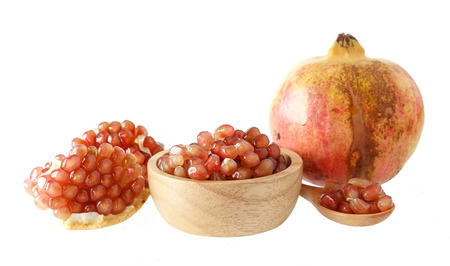 Group of fresh pomegranate - healthy fruit on white