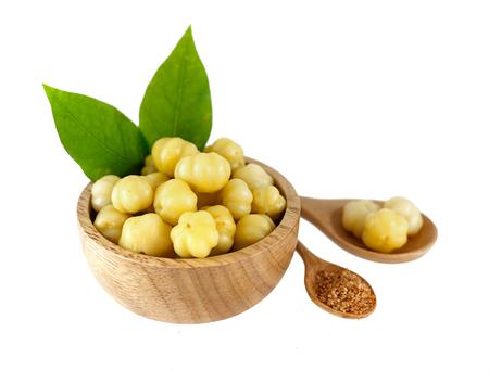 Preserved fruit - star gooseberry in wooden bowl on white