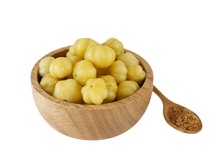 Bowl of preseved star gooseberry isolated on white Banque d'images