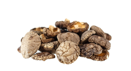 Group of dry shiitake mushrooms isolated on white