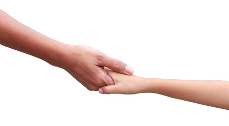 Helping hand concept -  hands holding each otheragainst green  background Banque d'images
