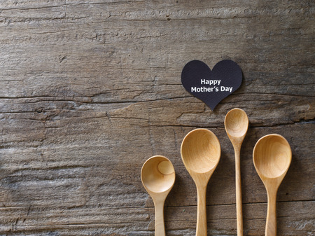 MOthers day background - wooden spoon arrange on plank with space