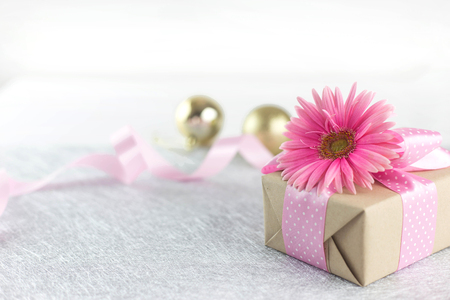 Happy celebration - Beautiful flower on giftbox with pink ribbon Stok Fotoğraf