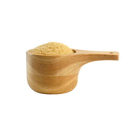 Wooden spoon and granulated brown sugar isolated on white