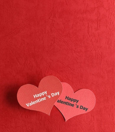 Valentines day - Two red hearts on red background