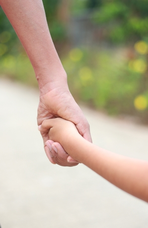 Family support - Asean father hold child hand with love