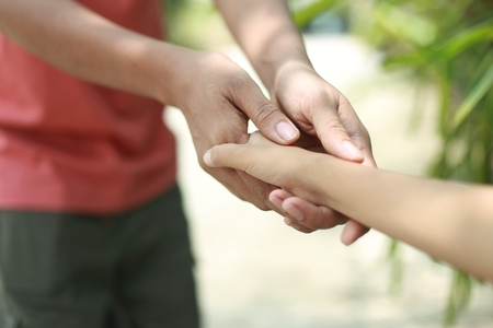 Family support - father hold child hand with love