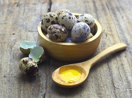 Close up of quail eggs on wooden background
