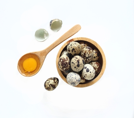 Top view of quail eggs isolated on white