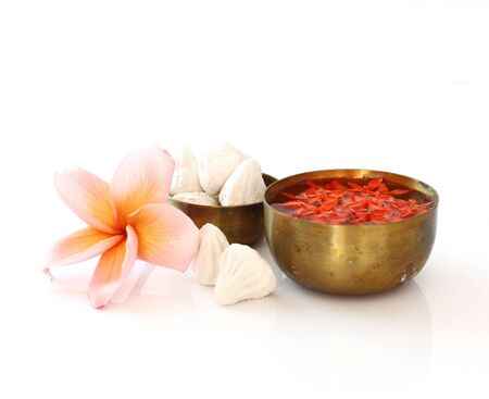 Thai Songkran festival - Group of bowl of water,flower and clay on white
