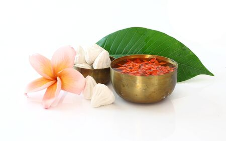 Bowl of water,flower and clay  on white background for Songkran festival Zdjęcie Seryjne