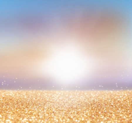 golden light: abstract of sunset, blurred-bokeh light background with golden glitter