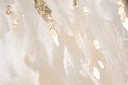 Christmas elegant background. Blurred abstract art gold foil backdrop. Luxury glamorous shiny festive soft wallpaper. Stylish, trendy and posh abstraction. Chic feminine neutral nude beige background. 写真素材
