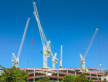 Construction site with cranes on a blue sky in London Stock Photo