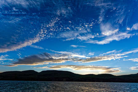 Dramatic sky with clouds pattern above Adirondack Mountains