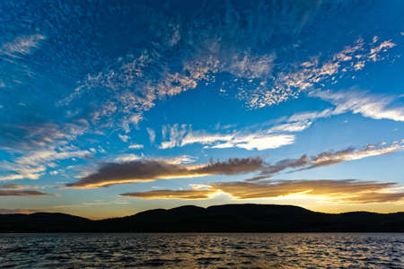 dreaminess: Dramatic sky with clouds pattern above Adirondack Mountains