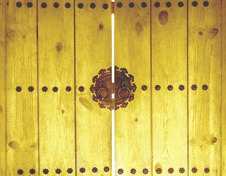 door knocker on wooden yellow.