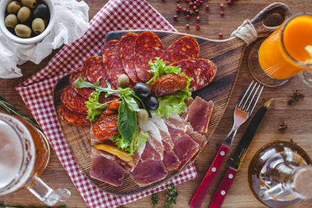 italian salami: Italian salami sliced on wooden table tableware carrot juice Stock Photo