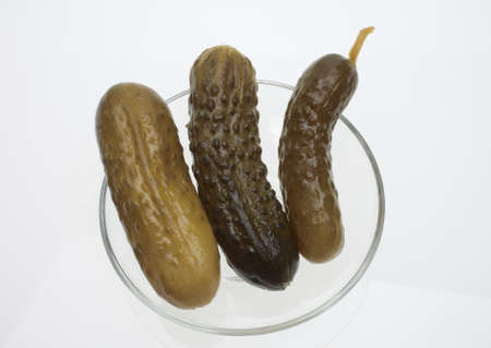 gherkin: pickled cucumber or sour gherkin over white Stock Photo