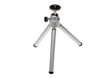 A small camera tripod on white ground Stock fotó