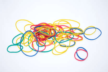 rubberband: A lot of colorful rubber bands over white